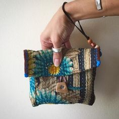 Kantha Wristlet with handmade oak wood button made by me. Features: wood button, leather strap for wrist and leather loop for closure and decorative wood beads. Fabric Purses, Fabric Bags, Fabric Scraps, Sewing Crafts, Sewing Projects, Japanese Quilts, Diy Tote Bag, Indian Fabric, Art Bag