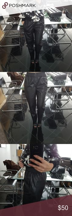 Zara Leather Effect Trousers Brand new with tags. Only worn for photo.  Authentic Zara leather effect trousers in black (2969/248). 100% polyurethane vegan leather. Super comfortable with a soft suede like lining and elastic waistband.  Length hits just at the end of ankles on me. Size XS fits as a size 4 in my opinion, could even fit a 6. Zara Pants Trousers