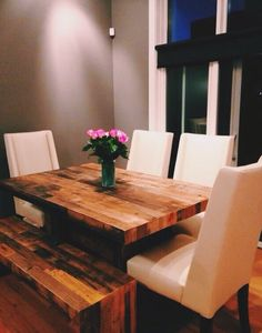 Butcher block dining table with white chairs