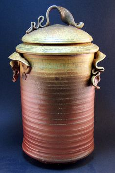 Tea Jar....  Wood fired with ash glaze on rim and lid. Leafy tendrils for handles
