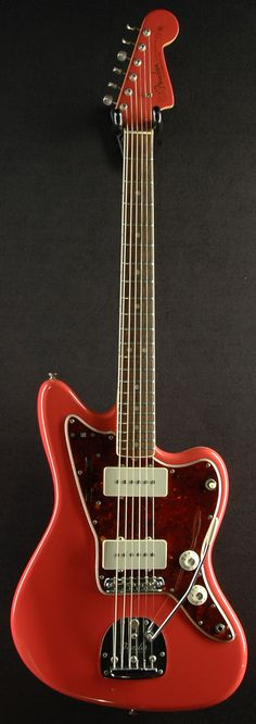 1965 Fender Jazzmaster.  I'm starting to really like the fiesta red-tortoiseshell color combo.