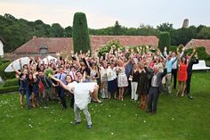 Love this photo! Groom holding bride and all the guests :)