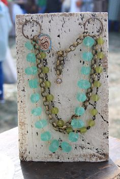 Tasha McKelvey's weathered painted display boards. Also a seriously cute necklace.