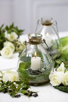lanterns make pretty centerpieces - would love to do in our little candle holders found on tea green chandeliers Candle Lanterns, Candle Jars, Candle Holders, Lantern Centerpieces, Glass Votive, Green Chandeliers, Deco Champetre, How To Make Lanterns, Deco Floral