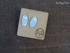 Ceramic earrings, little ovals. Baby blue with white dots. Mat finish.  Studs. about 2cm long.  These earrings were made by hand with the slip casting method. They are unique pieces.  Visit...