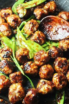 Serve these sticky, spicy Asian meatballs, glazed with a sriracha and honey sauce, over rice or noodles for an easy weeknight dinner, or by themselves for a crowd-pleasing party appetizer. These Asian Meatballs And Rice, Asian Meatballs, Ground Turkey Meatballs, Healthy Turkey Meatballs, Sauce For Meatballs, Turkey Meatball Sauce, Veggie Meatballs, Healthy Turkey Recipes, Chicken Recipes