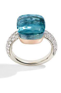 Pomellato Nudo ring in white gold and diamonds, set with a blue topaz so deep you could imagine diving into it.