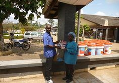 Maternal Childhealth Advocacy International | LIBERIA - MCAI newly published textbook being given for Free to Yamah Miller, midwife at Phebe Hospital, Liberia by Augustine Laveleh from ACDI Voca.