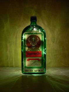 beer bottle candle holders | Jagermeister Green Glass Lighted Bottle by BoMoLuTra on Etsy
