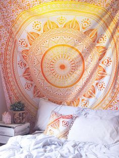 """Top off your bed or accent a wall with this unique boho tapestry, featuring a bold purple and pink mandala pattern on soft white fabric. This tapestry also doubles as a picnic blanket, perfect for festivals, beaches and more!Each tapestry cover is unique; Color and pattern placement will vary Approx. 96"""" L, 80"""" W Care/Washing Instructions: Hand wash cold, separately. Hang/Lay flat to dry 100% Cotton Handmade in India"""