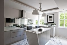 A coffered ceiling and single slab marble floor make for a striking yet sophisticated look in the kitchen