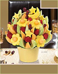 Edible Arrangements, maybe while we are getting our photos taken, we could have a few of these