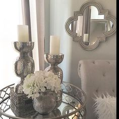 Perfect example of mirrored finishes and metallic decor for 2017. Want to keep the glamour high this year? This is super simple to accomplish at home.