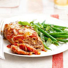 Mini Meat Loaves with Green Beans...20-Minute Dinner...These mini meat loaves are seasoned with fresh basil and topped with tangy tomato sauce and lots of mozzarella cheese. Green beans, which get a touch of heat from crushed red pepper, make a delicious side dish.