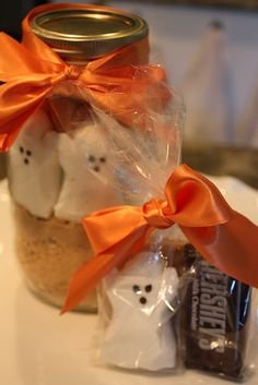 Halloween Peeps in a Jar    Crush one sleeve of graham crackers & layer the crumbs in the bottom of a one quart mason jar.   Place eight peeps (I favor the ghosts!) standing up and facing outwards against the glass.   (Be careful not to squish your ghosts!)  Spoon 1/3 cup of brown sugar into the middle of the jar to keep the Peeps in place.  Pour 1/2 cup of Halloween M over the brown sugar.    Empty the contents of the mason jar into a mixing bowl.  Cuts the Peeps up into smaller pieces.  ...