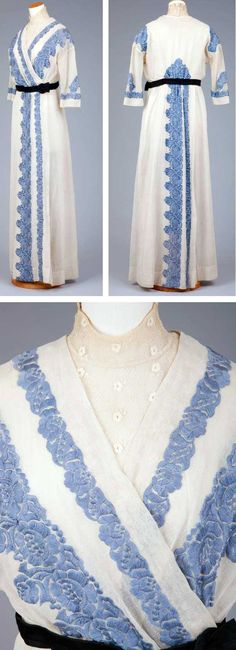 Day dress, 1912. White marquisette with a batiste lining. Drop shoulder with straight sleeves coming to below the elbow. Bodice has a surplice closing with an embroidered net vestee with a high-boned collar. Belt of folded black silk. Borders trimmed with medium blue bands of machine embroidery. Via Goldstein Museum of Design.