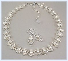 Bright white pearls are encircled with silver lined fire polished crystals and satin white glass seed beads. Picot/filigree edging