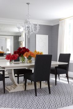 AnneHepferDesigns.com - grey textured walls & interesting pattern on rug in dining room