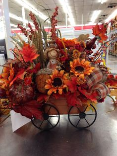 Fall wagon and scarecrow arrangement 2014