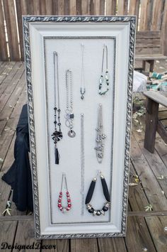 DIY Home Decor   This corkboard jewelry hanger was made from an old piece of artwork.