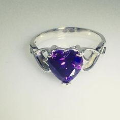 You can't help but fall in love with this gorgeous ring! The infinity heart accent band and glittering amethyst heart Swarovski Zirconia stone pair together perfectly. Visit Jewlr.com to customize this ring to suit your style. Available in your choice of silver, white gold, yellow gold and rose gold with whichever sparkling stone your heart desires!