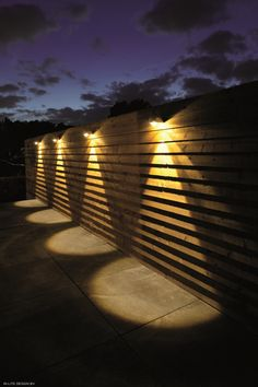 When designing your backyard, don't forget to carefully plan your lighting as well. Get great ideas for your backyard oasis here with our landscape lighting design ideas. Outside Lighting Ideas, Fence Lighting, Backyard Lighting, Outdoor Wall Lighting, Exterior Lighting, Diy Fence, Backyard Fences, Backyard Landscaping, Fence Design