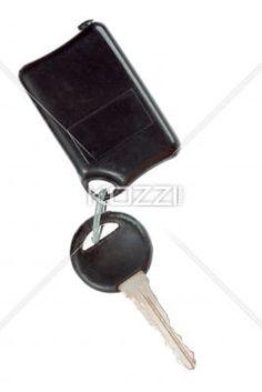 modern day car key. - Modern day car key displayed on white.