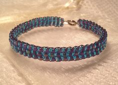 Beaded bracelet - blue with a purple tinge - handmade from quality Japanese seed beads. Includes cream organza gift bag. on Etsy, $12.50 AUD