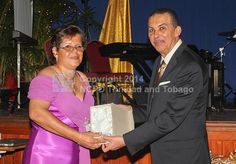 His Excellency Anthony Thomas Aquinas Carmona, O.R.T.T., S.C. presented Sharon Rochard with her long service award.