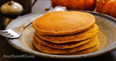 These Cinnamon Paleo Pumpkin Pancakes are warm and comforting—perfect for a crisp fall morning!