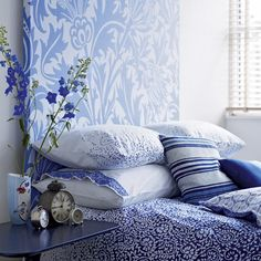 My daughter is wanting to switch to a blue bedroom, I like this mix of patterns for her, could be fun!