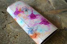 A personal favorite from my Etsy shop https://www.etsy.com/listing/226141511/leather-trifold-wallet-marble-dye