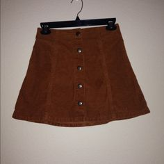 Topshop mini skirt Super cute topshop mini skirt in a brown corduroy material. This skirt has a high waist fit. Size us 2 fits an xs. Topshop Skirts Mini