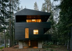This northern California cabin by Mork-Ulnes Architects is clad in tar-coated timber and sits atop a concrete plinth