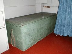 Archive photo: Flat top sea chest, painted seafoam green; rope handles, till on left inside. Carpenter's chest, possibly. Circa 19th century. Object ID: X.0575  Normally housed in the Pantry of the Old Kitchen in the Atwood House. #seachest, #carpenterschest, #chest, #pantry, #kitchen, #atwoodhouse, #chathamhistoricalsociety, #chatham, #capecod