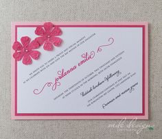 pink and fuchsia bat mitzvah invitation with handmade flowers embellished with crystals and unique diagonal layout
