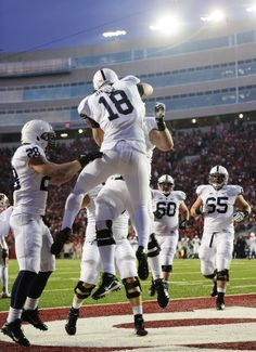 PENN STATE – FOOTBALL 2013 – TIGHT END Jesse James reaches over Wisconsin safety to catch seven-yard touchdown pass from Hackenberg in third quarter, then celebrates with teammates.