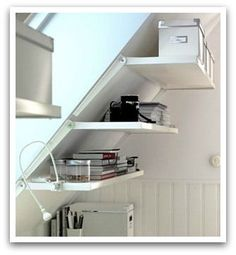 """hanging storage in a slanted ceiling room 