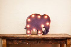 """20"""" Elephant Marquee in purple. Made of foam core, poster board and globe lights. $15 total. W/ dimmer switch $27.  https://www.facebook.com/lovelyluminaries"""