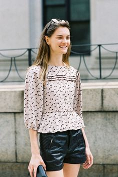 anouk lepere combining a sweet, girly blouse with harder leather shorts... photo by: vanessa jackmann