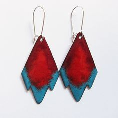 There's nothing like a pair of dangling red tribal earrings to bring out the boho babe in all of us. The geometric aztec shape is enameled in red, dark red (wine) and turquoise blue with red enamel ba