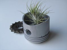 Piston Planter Flower Pot Industrial Look Upcycled Motorcycle Piston. $5.00, via Etsy.