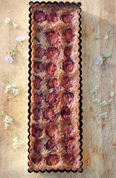 This Plum Almond Tart recipe is a variation on a frangipane - a French almond-based filling that is topped with fruit and baked in a tart shell.
