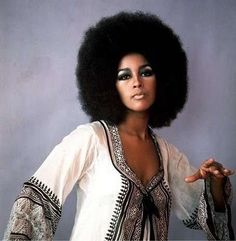 Marsha Hunt in a lovely 1960's 1970s top and large afro hair.