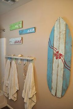 LOTS of totally cute beachy ideas here  http://seeshellspace.blogspot.com/2013/05/my-beachy-bathroom-makeover-for-under-30.html