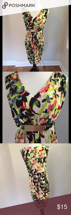 Thalia Sodi dress, size M Women's wear-to-work dress with bold, flowery pattern and cute gold hardware on front. Comfortable, knee-length dress and a bonus -- pockets!  Size M - would fit size 6-8. Clean clothing from non-smoking home. Thalia Sodi Dresses Midi
