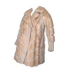 Natural champagne or blonde honey mink panels accented with rich ivory leather details in chevron stipe pattern. Car coat 3/4 length