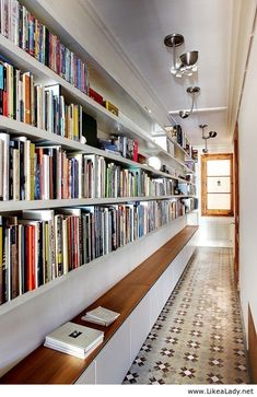 Whoa, wonder if the hallway is wide enough for this! It's certainly long....  Hallway library http://www.janetcampbell.ca/