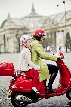 A mother rides her daughter on a red vespa on Les Champs Elysees #paris #streetphoto