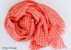 Expand your wardrobe with a See Design soft, fine knit 100% wool scarf. The bright colors and the beautiful patterns make it the perfect accessory. It measures 30 inches by 70 inches.